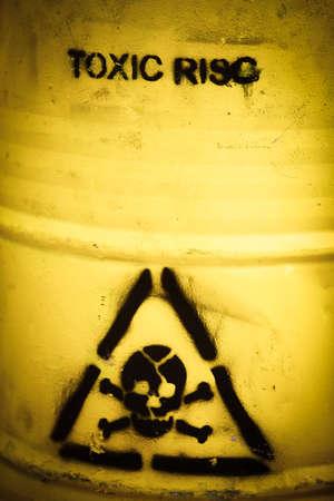 Toxic waste symbol on a yellow barrel. photo