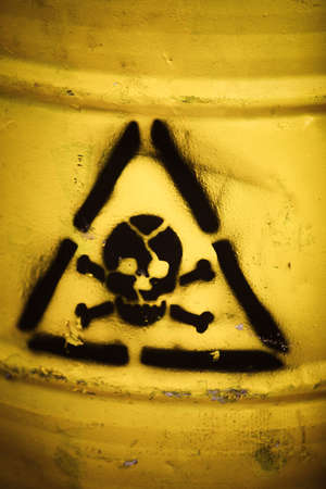 Toxic waste symbol on a yellow barrel. photo