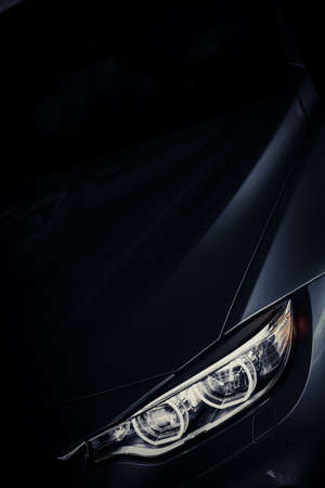 xenon: Detail on one of the LED headlights of a car. Editorial