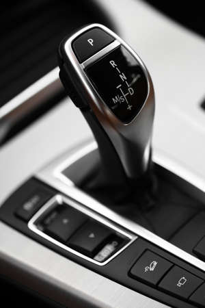 shifter: Detail on a automatic gear shifter in a new car. Stock Photo