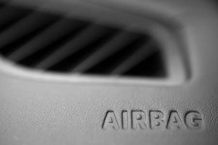 The word Airbag is written inside a car. photo