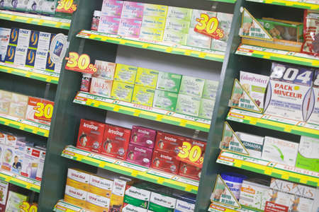 retail therapy: Bucharest, Romania - October 14, 2014: Color shot of some shelves filled with medicine in a pharmacy in Bucharest, Romania.