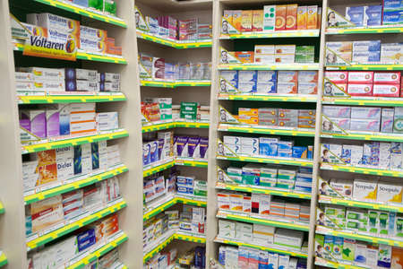 Bucharest, Romania - October 14, 2014: Color shot of some shelves filled with medicine in a pharmacy in Bucharest, Romania.