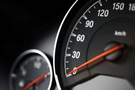 a close up: Close up shot of a speedometer in a car.