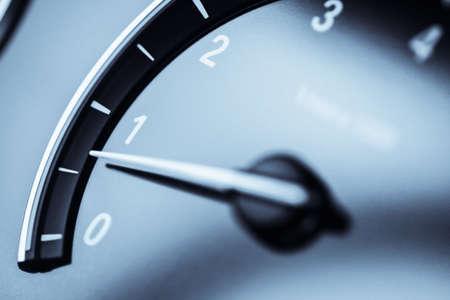 Detail of a tachometer in a car.