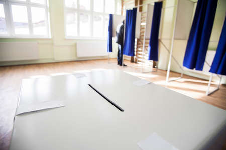 poll: Color shot of a poll at a polling station. Stock Photo