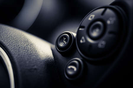 hands free phones: Detail on some buttons on a cars steering wheel. Stock Photo