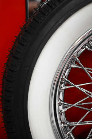 spoke: Color vertical shot of a vintage cars spoke wheel. Stock Photo