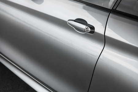 door handle: Color horizontal shot of a car door handle. Stock Photo