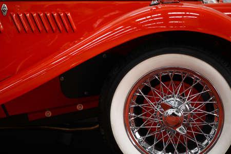 spoke: Color horizontal shot of a vintage cars spoke wheel.