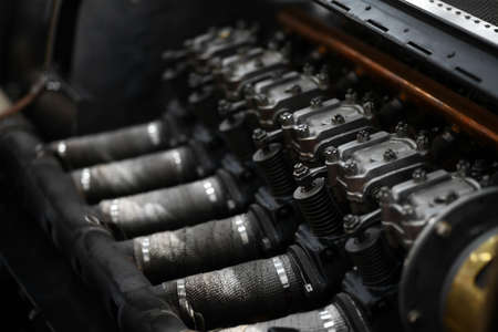 exhaust valve: Color horizontal shot of a vintage cars engine.