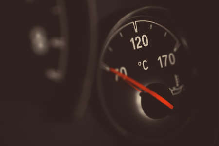 coolant: Coolant temperature gauge on a cars dashboard.
