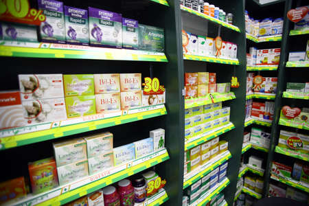 health care decisions: Bucharest, Romania - October 23, 2014: Color shot of some shelves filled with medicine in a pharmacy in Bucharest, Romania.