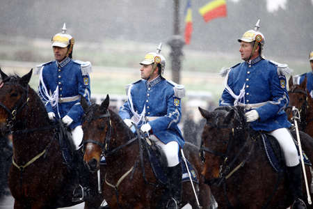 ceremonial clothing: Bucharest, Romania - December 1, 2014: Mounted soldiers ride horses during celebrations for Romania