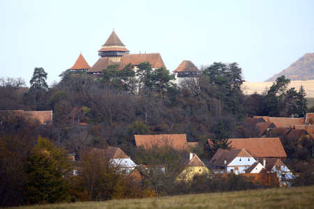 fortified: Color shot of the fortified church in Viscri, Romania. Stock Photo