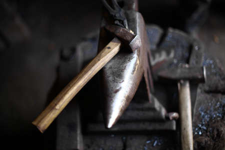anvil: Color shot with a hammer and an anvil.