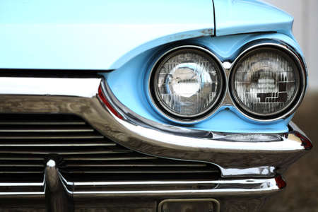 restoring: Color detail on the headlight of a vintage car. Stock Photo