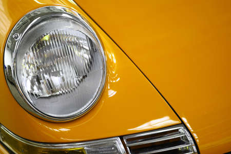Color detail on the headlight of a vintage car. Stock Photo