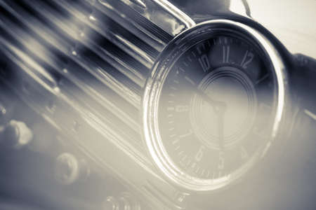 old interior: Color shot of a vintage clock on a cars dashboard.
