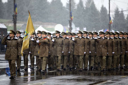 ceremonial clothing: Bucharest, Romania - December 1, 2014: Soldiers march during celebrations for National Day of Romania in Bucharest, Romania. Editorial