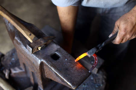 anvil: Color shot with a hammer, a horse shoe and an anvil.