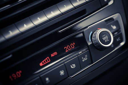 Detail with the air conditioning button inside a car. Standard-Bild