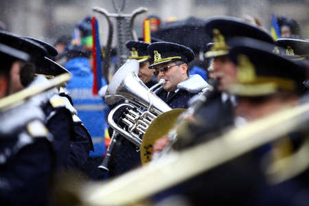 saxhorn: Bucharest, Romania - December 1, 2014: Orchestra musician plays the saxhorn during celebrations for National Day of Romania in Bucharest, Romania.