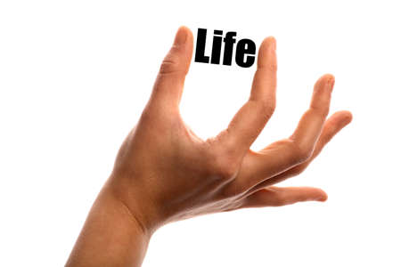 retire: Horizontal shot of a hand holding the word Life between two fingers, isolated on white.