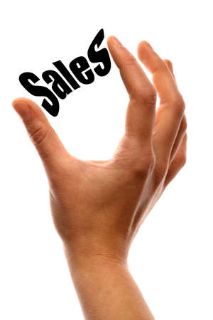 cost reduction: Close up shot two fingers squeezing the word Sales.