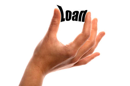 exact: Horizontal shot of a hand squeezing the word Loan between two fingers, isolated on white.