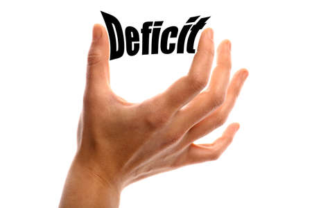 deficit: Horizontal shot of a hand squeezing the word Deficit between two fingers, isolated on white. Stock Photo
