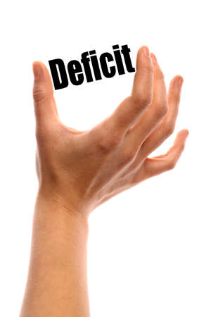 deficit: Vertical shot of a hand holding the word Deficit between two fingers, isolated on white. Stock Photo