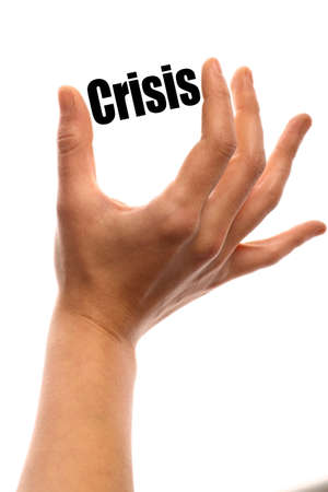 exact: Vertical shot of a hand holding the word Crisis between two fingers, isolated on white.