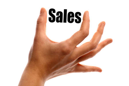 exact: Horizontal shot of a hand holding the word Sales between two fingers, isolated on white.