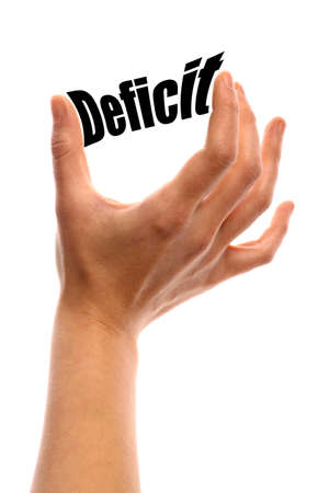 deficit: Vertical shot of a hand squeezing the word Deficit between two fingers, isolated on white.