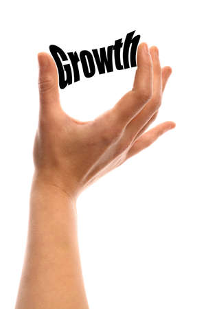 exact: Vertical shot of a hand squeezing the word Growth between two fingers, isolated on white. Stock Photo