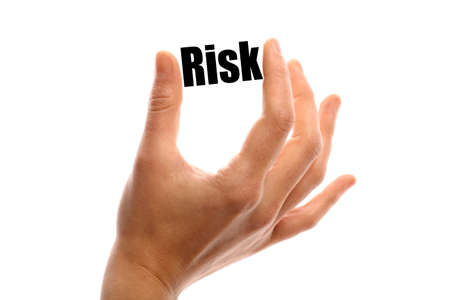 exact: Horizontal shot of a hand holding the word Risk between two fingers, isolated on white.