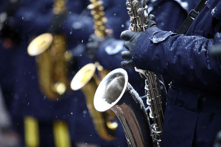 Color image of a saxophone being played on a snowy day. photo