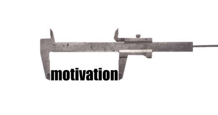 exact: Color horizontal shot of a caliper measuring the word motivation. Stock Photo