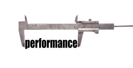caliper: Color horizontal shot of a caliper measuring the word performance.