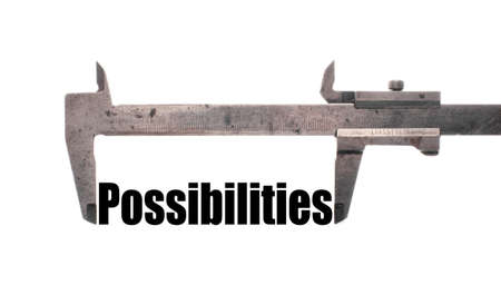 feasible: Color horizontal shot of a caliper and measuring the word possibilities. Stock Photo