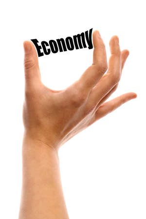 fiscal: Vertical shot of a hand holding the word Economy between two fingers, isolated on white.
