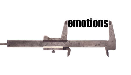 sensitivity: Color horizontal shot of a caliper measuring the word emotions. Stock Photo