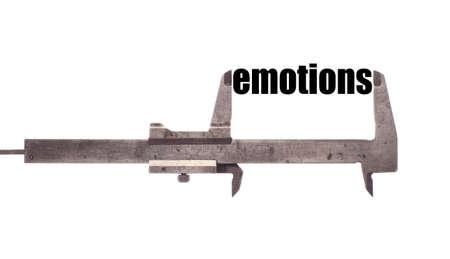 "humanism: Tiro horizontal de color de una pinza de medici�n de la palabra ""emociones""."