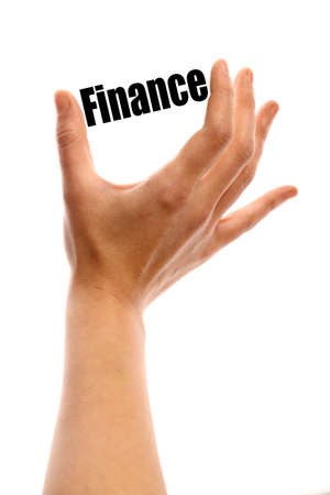 stock price losses: Vertical shot of a hand holding the word Finance between two fingers, isolated on white.