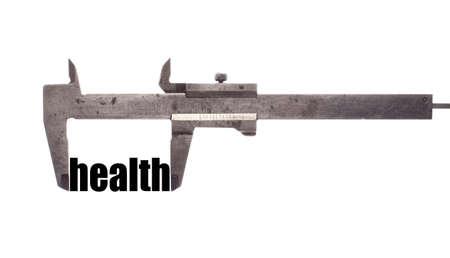 health symbols metaphors: Color horizontal shot of a caliper and measuring the word health.