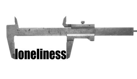 Color horizontal shot of a caliper and measuring the word loneliness.