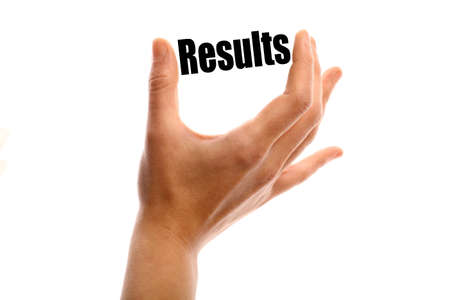 exact: Horizontal shot of a hand holding the word Results between two fingers, isolated on white.