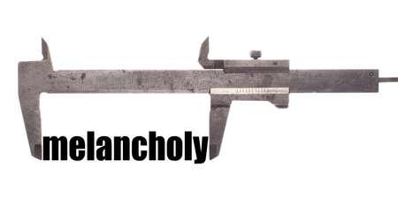 melancholy: Color horizontal shot of a caliper measuring the word melancholy.