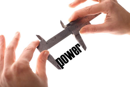 powerful creativity: Color horizontal shot of two hands holding a caliper measuring the word power.
